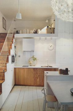 I like the glass rail...visually opens up the space. And kitchen storage built into the stairs.