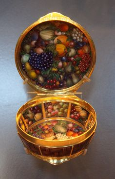 Basket-shaped Snuffbox - V    About 1775.  Probably St Petersburg, Russia  Enamels probably by Charles-Jacques de Mailly (1740-1817)  Enamelled gold, interior enamelled with fruit and vegetables.