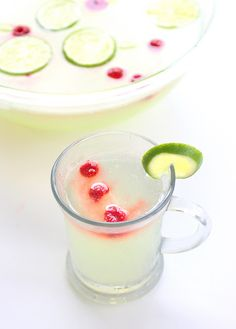 Limeade Punch (1 (12 oz) can frozen limeade concentrate  1 (2 liter) bottle Sprite  frozen raspberries or sliced limes for garnish)