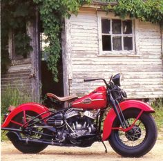 Flathead Motorcycle Parked By Abandoned Old House