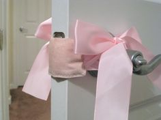 Door muff with a bow ... Allows you to open and close baby's door without making a sound, keeps little ones from shutting themselves in the room, and no more smashed fingers