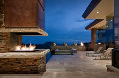 Multiple outdoor #fireplaces and fire features, for an ample deck with great views.