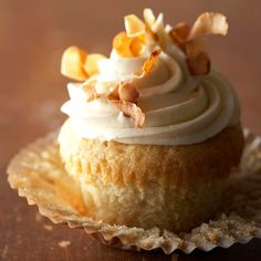 Vanilla Bean-Coconut Cupcakes topped with toasted coconut flakes. Yum! More cupcake recipes: http://www.bhg.com/recipes/desserts/cupcakes/our-best-cupcake-recipes/