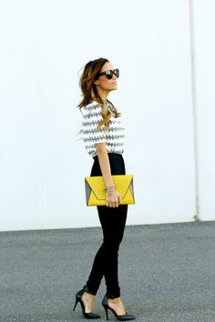 striped top, black skinnies and heels, yellow clutch