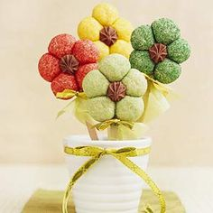 Sugar cookie dough balls are rolled in colored sugar, then formed into a flower to make these pretty cookies: http://www.recipe.com/easy-flower-cookies-on-sticks/?socsrc=recpin041212flowercookies