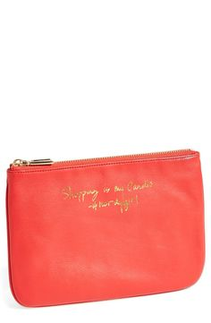 This leather pouch says it all: Shopping is my cardio