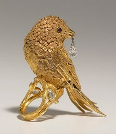 The bird is a ring and it has a diamond briolette in its mouth