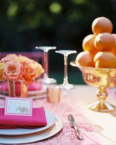 Place settings and centerpieces in a pink-and-orange palette