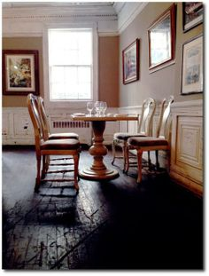 Fraunce's Tavern - white dentil crown molding, light brown walls, white chair rail and paneling, black floors