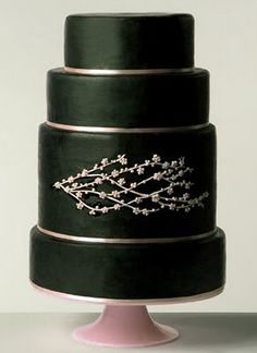Onyx and pink wedding cake with cherry blossom branches