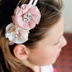 Make these bejewelled fabric flowers and attach to a headband to create the latest look. Gorgeous for Valentine's Day. DIY included
