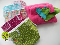 Baby Doll Accessories Tutorial  (Part 1: diapers, wipes and wipes case)  Materials Needed:  *Scrap pieces of fleece, felt or any other non-fraying material  *Cotton fabric scraps or a fat quarter if you want them to all match  *Minky fabric or flannel scraps  *1/2″ sew on velcro