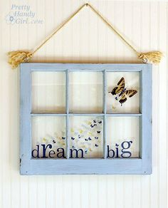 old window becomes a beautiful piece of art/decoration. Love taking the old and making it new!