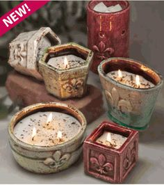 soy candles and very fragrant. the best part - refills are available for the pottery
