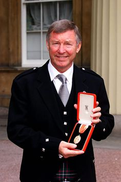 12 June 1999 - Manchester United manager Alex Ferguson is knighted by the Queen