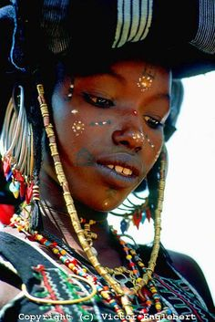 Niger. Sahel. Wodaabe (Bororo/Fulani) nomad girl attending a Yakey; a male dance and beauty contest.