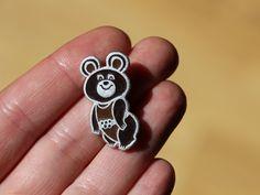 Russian metal pin MISHA, mascot bear from Olympic Games Moscow 1980. $8.50, via Etsy.