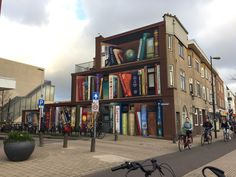 Street Artist Transforms an Ordinary Building Into a Spectacular Bookcase