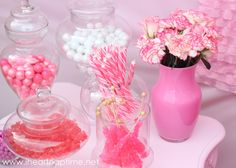 Yummy candy station w/ painted pink vanity and painted vases #diy party
