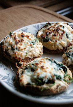 yummy hummus melts- whole wheat English muffin topped with hummus, sauteed spinach and mozzarella cheese- so easy.