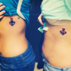 Matching bow & anchor tattoos