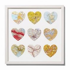 Punched map hearts from special areas... hometown, honeymoon, college town, first apartment... love this idea for recycling an old atlas!