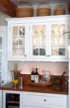 Wood counter, white cabinets...