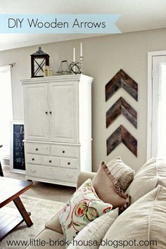 Little Brick House: Reclaimed Wood Project: DIY Wooden Arrows.  I like the colors in this room. Fresh