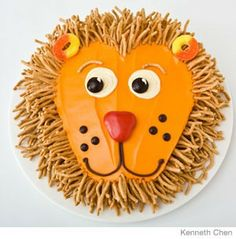Lion Birthday Cake Design Sweet! How to make a lion birthday cake with chow-mein noodles. Easy, step-by-step recipe, diagrams and pictures By Karen Tack email print share related tags: birthday parties, Birthday_Parties--Recipes, Recipes  comments (0)           31 Incredible Birthday Cake Designs Step-by-step recipes, designs and color pics of the easiest (and cutest) birthday cakes for boys and girls  Serves 16  Ingredients:  1 (9-inch) round cake 1 can (16 oz) vanilla frosting Orange food c...