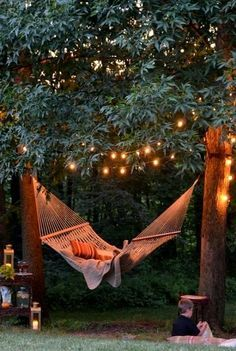 LOVE LOVE LOVE this backyard hammock and tree lights!!