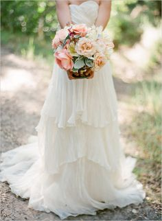 peach wedding bouquet and tiered dress
