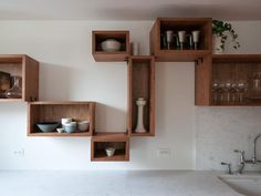 Remodelista, Workstead, Brooklyn Heights, cherry hardwood storage boxes on white kitchen wall