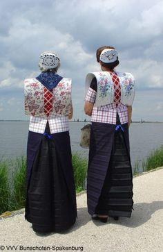 Europe | Portrait of two women wearing traditional clothes, Bunschoten, Utrecht, The Netherlands