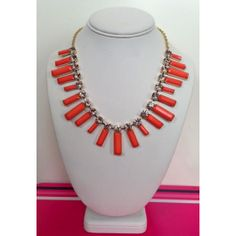 As lively as its namesake, the Audrey Necklace is absolutely delightful.    The details: Coral or White acrylic crystals adorn gold tone chain.  The acrylic drops measure 1.25 inches in length and the necklace itself measures 19 inches long with a three inch extension chain. Secures with a lobster clasp closure.