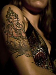Ganesha on his lotus tatoo