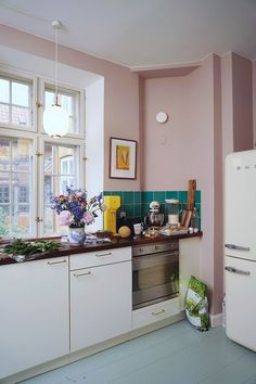 Pink, green and yellow kitchen in Copenhagen, Nyhavn.