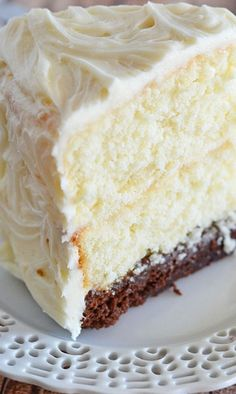 This Vintage Cake combines two layers of white cake, with a surprise brownie layer soaked in a decadent chocolate sauce.