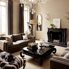 Warm tones of brown and beige mix harmoniously with creamy whites to bring an elegant and welcoming atmosphere in the living room.. love this! wall colors, coffee tables, color palettes, living rooms, living room colors, fireplac, live room, room color schemes, black furniture