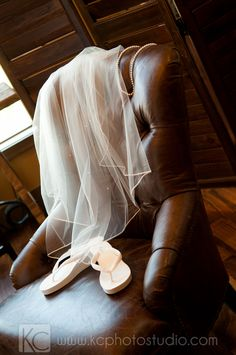 Wedding veil, pearl necklace, and ... flip flops of course!