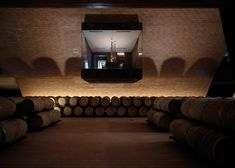 Huge terracotta wine vaults are concealed beneath a vineyard at this winery outside Florence.