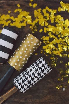black and gold confetti poppers // photo by Nancy Ebert // http://ruffledblog.com/black-gold-new-years-eve