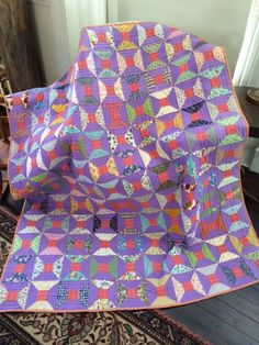 Hand quilted spools quilt,  Littledoequilts.com