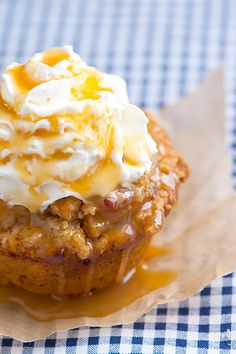 Apple Pie Cupcakes filled with sautéed apple, topped with apple streusel, whipped cream and a drizzle of caramel syrup