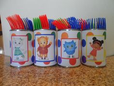 Using empty cans, card stock paper, I put Daniel Tiger characters over colorful polka dots background to hold colorful plastic eating utensils.