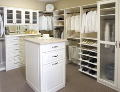 Walk-in-closets - island storage, drawers and layout are all good