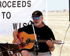 Martin Kozack sings on the beach at Leaming Avenue. During his sets, all the tips given will be donated to the Make a Wish Foundation.