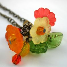 Bright colorful flowers beads decorate this necklace.  Click on the picture to learn more about it. $23