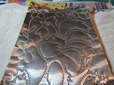 faux punched tin craft from aluminum cookie sheet