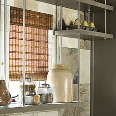 Suspended Shelves | Open backed shelves are great for small kitchens. Install them in front of windows for extra storage while still allowing light to come in. | SouthernLiving.com