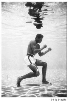 """Life magazine ran one of the late Flip Schulke's photographs of Muhammad Ali in 1961 """"training"""" underwater in a Miami swimming pool. Ali swore that the underwater workouts made him the fastest heavyweight in the world."""